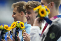 Robert Finke, of United States, poses after winning the gold medal in a men's 1500-meter freestyle final at the 2020 Summer Olympics, Sunday, Aug. 1, 2021, in Tokyo, Japan. (AP Photo/David Goldman)