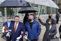 Michael Skakel, center, looks on as an attorney talks to reporters outside a courthouse in Stamford, Conn., Friday, Oct. 30, 2020. A Connecticut prosecutor says the Kennedy cousin will not face a second trial in the 1975 murder of teenager Martha Moxley in Greenwich. Chief State's Attorney Richard Colangelo Jr. made the announcement Friday at the state courthouse in Stamford. (AP Photo/Seth Wenig)