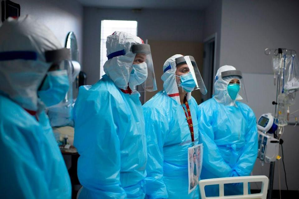 <p>Medical staff are pictured in a Houston, Texas, hospital on Friday as a new forecast put the estimated death toll at 500,000 by April</p> (AFP /AFP via Getty Images)