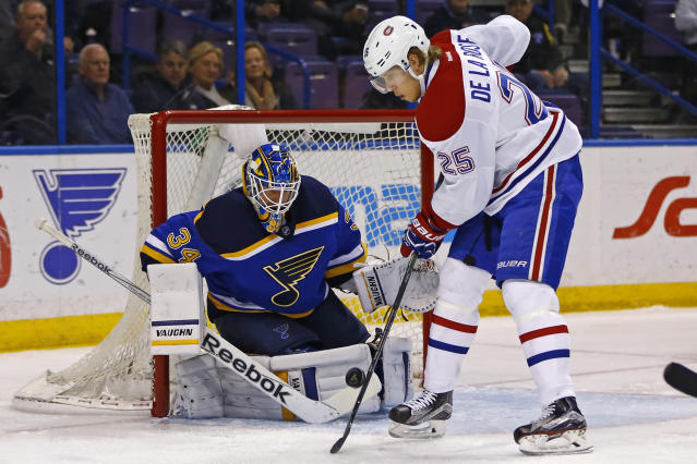 Montreal Canadiens' Jacob De La Rose, of Sweden, tips the shot in front of St. Louis Blues goalie Jake Allen during the first period of an NHL hockey game Tuesday, Feb. 24, 2015, in St. Louis. (AP Photo/Billy Hurst)