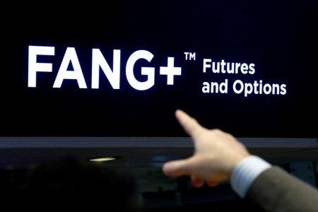 FILE PHOTO: A trader points to a screen that displays FANG+, group of highly-traded technology and tech-enabled companies, on the floor of the New York Stock Exchange (NYSE) in New York, NY, U.S., July 11, 2018. REUTERS/Brendan McDermid/File Photo
