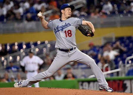 May 17, 2018; Miami, FL, USA; Los Angeles Dodgers starting pitcher Kenta Maeda (18) throws in the first inning against the Miami Marlins at Marlins Park. Mandatory Credit: Steve Mitchell-USA TODAY Sports