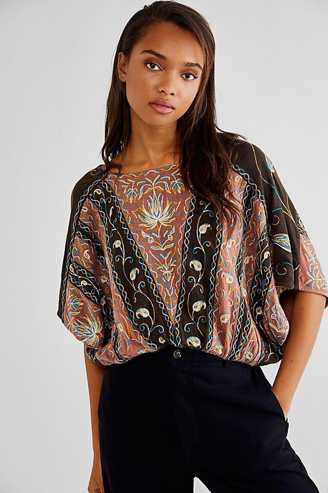 """<br><br><strong>Free People</strong> Valley Tee, $, available at <a href=""""https://go.skimresources.com/?id=30283X879131&url=https%3A%2F%2Fwww.freepeople.com%2Fshop%2Fvalley-tee%2F"""" rel=""""nofollow noopener"""" target=""""_blank"""" data-ylk=""""slk:Free People"""" class=""""link rapid-noclick-resp"""">Free People</a>"""