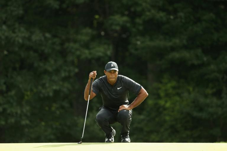 Tiger Woods struggled in hitting only half of the 18 Boston greens to post a one-over-par 72