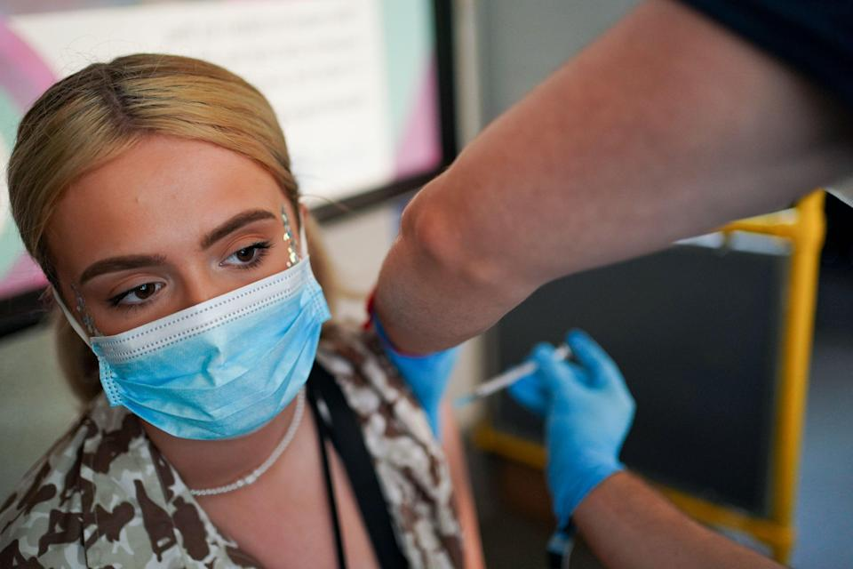 Young woman receives her second Pfizer vaccine  (PA Wire)