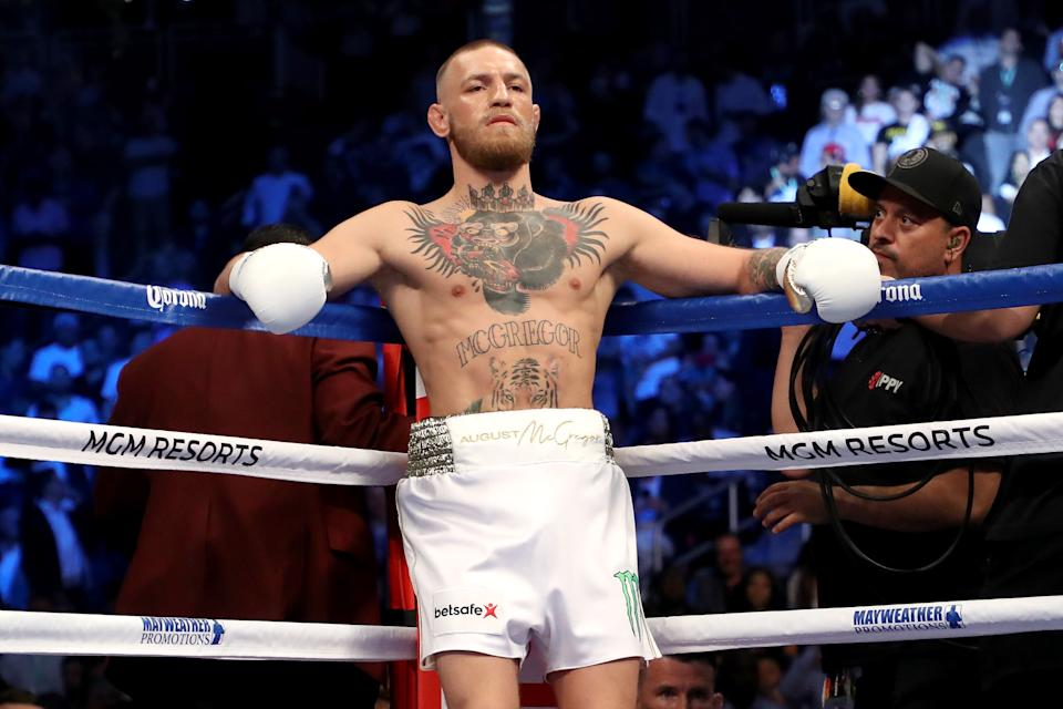 Conor McGregor stands in his corner during his super welterweight boxing match against Floyd Mayweather Jr.