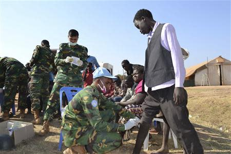 Handout photo of medic peacekeepers from UNMISS treating civilians at their compound in the outskirts of Juba