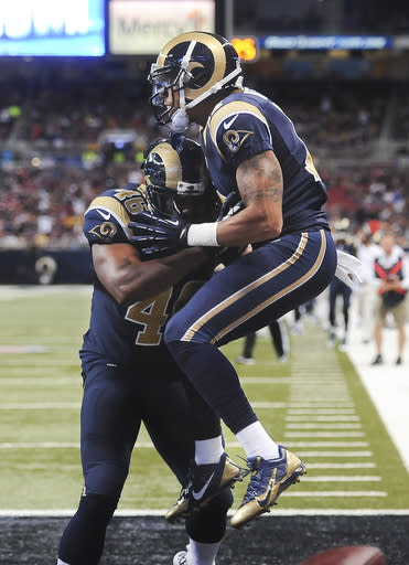 St. Louis Rams wide receiver Stedman Bailey, right, celebrates with tight end Cory Harkey after Bailey scored on a reception during the second quarter of a preseason NFL football game against the New Orleans Saints on Friday, Aug. 8, 2014, in St. Louis. (AP Photo/L.G. Patterson)
