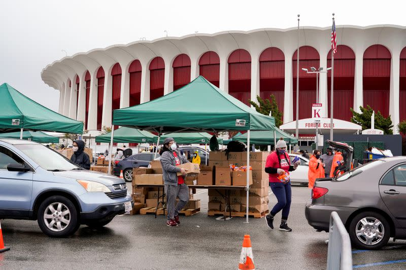 Volunteers with Los Angeles County Federation of Labor, AFL-CIO, hand out boxes of food to LAX workers in the parking lot of The Forum during the outbreak of the coronavirus disease (COVID-19), in Inglewood