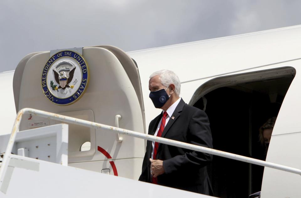 Vice President Mike Pence emerges from Air Force Two after arriving at Tampa Airport on Wednesday Aug. 5, 2020, with plans to visit the Hilton Clearwater Beach Resort & Spa in Clearwater as part of his 'Faith in America' tour. (Douglas R. Clifford/Tampa Bay Times via AP)