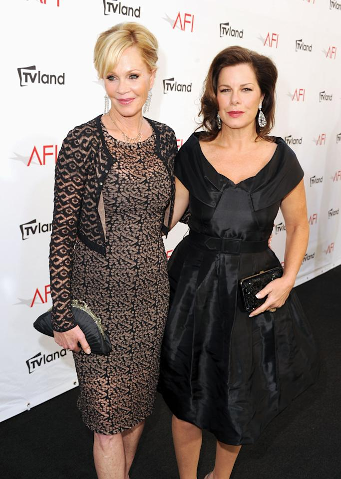 Melanie Griffith and Marcia Gay Harden arrive at AFI's 40th Annual Life Achievement Award held at Sony Pictures Studios on June 7, 2012 in Culver City, California.