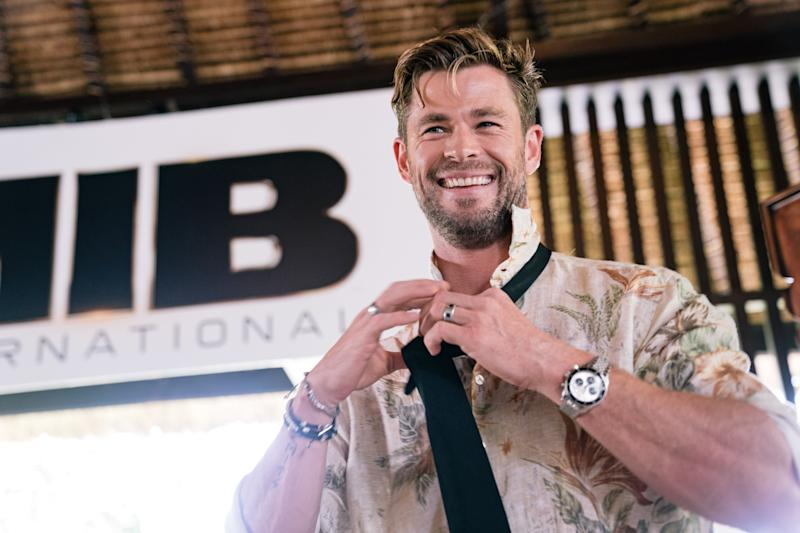 """NUSA DUA, INDONESIA - MAY 27: Chris Hemsworth gives master class on how to tie the iconic MIB tie at """"Men In Black: International"""" event at the St Regis Bali on May 27, 2019 in Nusa Dua, Indonesia. (Photo by Anthony Kwan/Getty Images for Sony Pictures Entertainment)"""