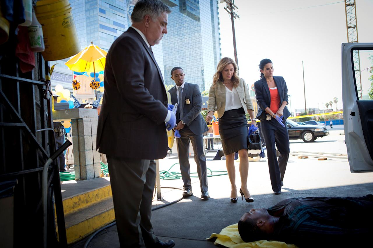 "Bruce McGill, Lee Thompson Young, Sasha Alexander, and Angie Harmon in the ""Rizzoli & Isles"" episode, ""Over/Under."""