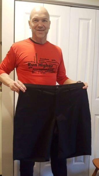 PHOTO: Andy Bell, 45, poses with shorts he wore before his 100-pound weight loss. (Andy Bell)