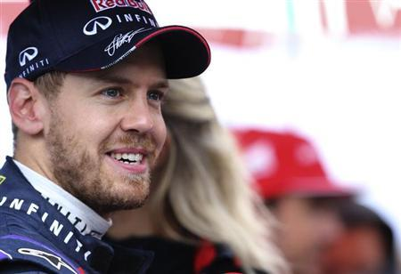 Red Bull Formula One driver Sebastian Vettel of Germany speaks during an interview after the qualifying session of the Brazilian F1 Grand Prix at the Interlagos circuit in Sao Paulo November 23, 2013. REUTERS/Paulo Whitaker
