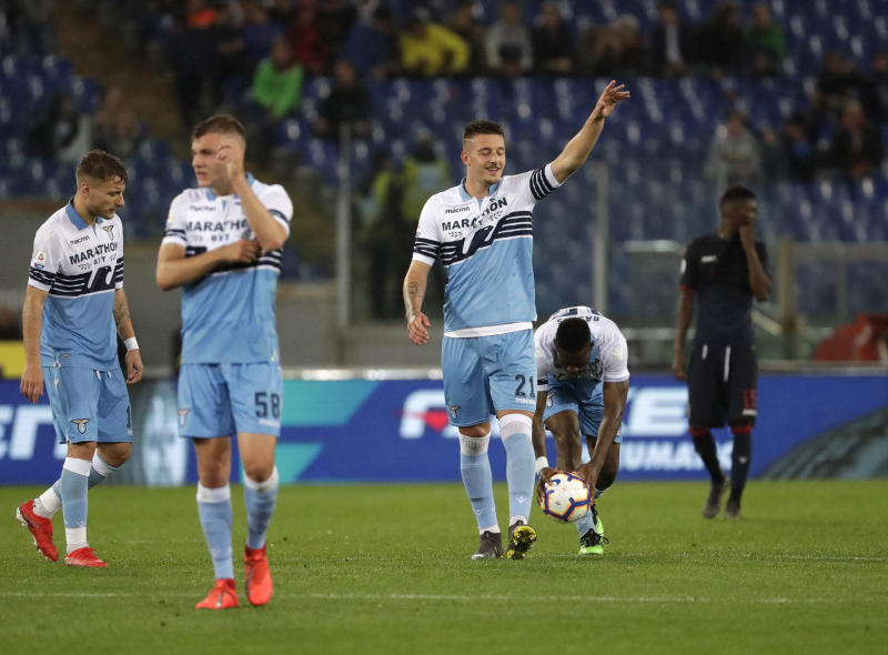 Lazio's Sergej Milinkovic Savic celebrates after scoring his side third goal during an Italian Serie A soccer match between Lazio and Bologna, at the Olympic stadium in Rome, Monday, May 20, 2019. (AP Photo/Andrew Medichini)