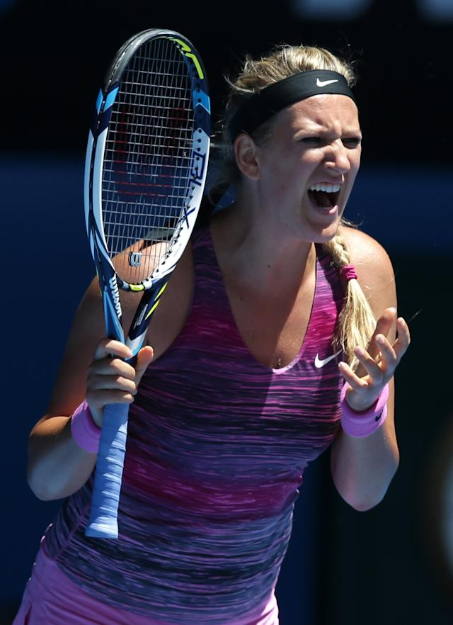 Victoria Azarenka of Belarus reacts after losing a point during her quarterfinal against Agnieszka Radwanska of Poland at the Australian Open tennis championship in Melbourne, Australia, Wednesday, Jan. 22, 2014.(AP Photo/Aaron Favila)