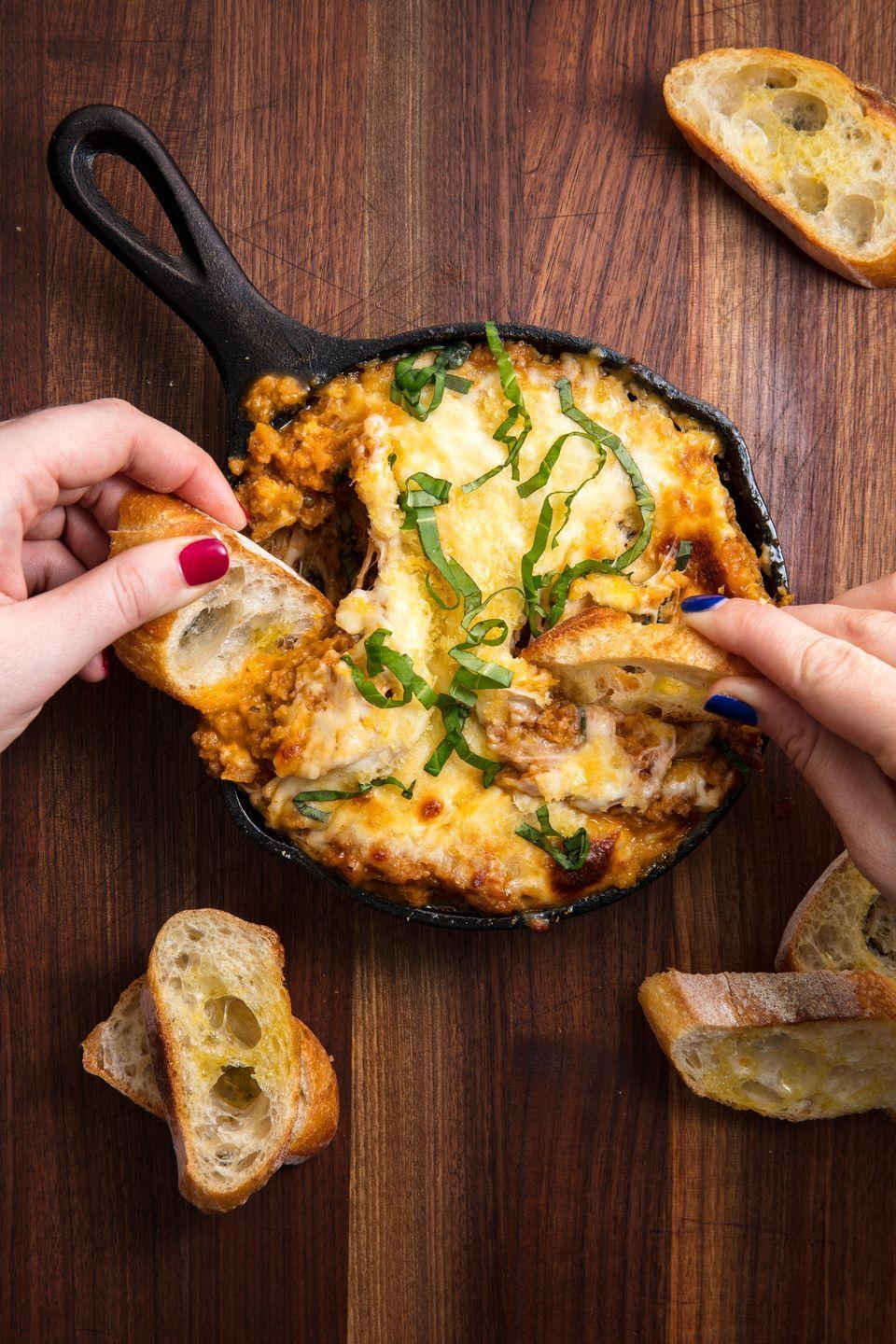 """<p>Everything you love about eggplant Parm, melted together in one cheesy dip. (Extra credit for serving with grilled bread.)</p><p>Get the recipe from <a href=""""https://www.delish.com/cooking/recipe-ideas/recipes/a48047/eggplant-parm-dip-recipe/"""" rel=""""nofollow noopener"""" target=""""_blank"""" data-ylk=""""slk:Delish"""" class=""""link rapid-noclick-resp"""">Delish</a>.</p>"""