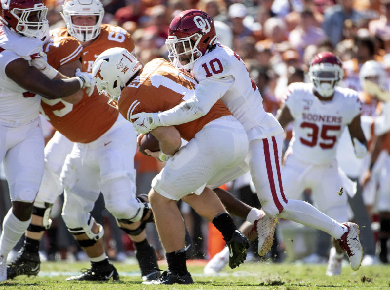 Oklahoma safety Pat Fields (10) sacks Texas quarterback Sam Ehlinger (11) in the first half of an NCAA college football game at the Cotton Bowl, Saturday, Oct. 12, 2019, in Dallas. (AP Photo/Jeffrey McWhorter)