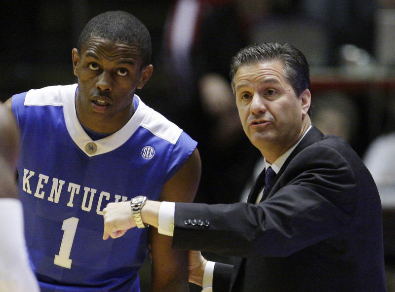 ** CORRECTS ID OF PLAYER TO DARIUS MILLER, NOT ERIC BLEDSOE. ** FILE - In this Dec. 12, 2009, file photo, Kentucky head coach John Calipari, right, talks to forward Darius Miller (1) during the first half of an NCAA college basketball game against Indiana in Bloomington, Ind. Calipari keeps waiting for Miller to play up to his capabilities during the 2010 season. The junior forward has disappeared at times for the No. 17 Wildcats, something that will have to change heading into Saturday's, Dec. 11, 2010, game against Indiana. (AP Photo/Darron Cummings, File)