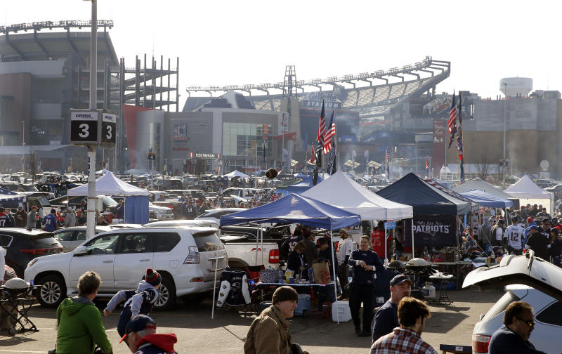 Fans tailgate in the parking lot of Gillette Stadium before the AFC championship NFL football game between the New England Patriots and the Jacksonville Jaguars, Sunday, Jan. 21, 2018, in Foxborough, Mass. (AP Photo/Winslow Townson)
