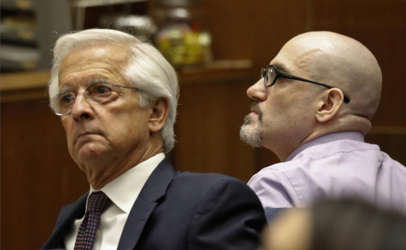 FILE - In this May 2, 2019 file photo Michael Gargiulo, right, appears with his defense attorney Daniel Nardoni in Los Angeles Superior Court for opening statements on his trial on murder charges in Los Angeles. Jurors have reached a verdict Thursday, Aug. 15, in the case of Gargiulo who is charged with fatally stabbing two women in their Southern California homes and attempting to kill a third. (Al Seib/Los Angeles Times via AP, Pool, File)