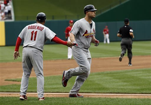 St. Louis Cardinals Matt Holliday, right, celebrates with third base coach Jose Oquendo as he heads home after his two-run homer during the third inning of a baseball game with the Washington Nationals at Nationals Park Saturday, Sept. 1, 2012, in Washington. (AP Photo/Alex Brandon)