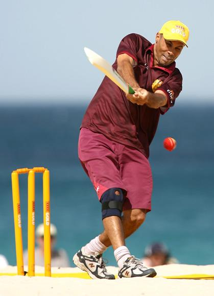 Jimmy Adams of the West Indies hits out during the Beach Cricket Tri-Nations match on Scarborough Beach January 27, 2007 in Perth, Australia  (Photo by Paul Kane/Getty Images) *** Local Caption *** Jimmy Adams