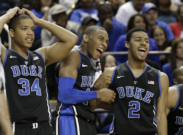 Duke players, from left, Andre Dawkins, Rasheed Sulaimon, and Quinn Cook react to a teammate missing a shot late in the second half of an NCAA college basketball game against Elon in Greensboro, N.C., Tuesday, Dec. 31, 2013. Duke won 86-48. (AP Photo/Chuck Burton)