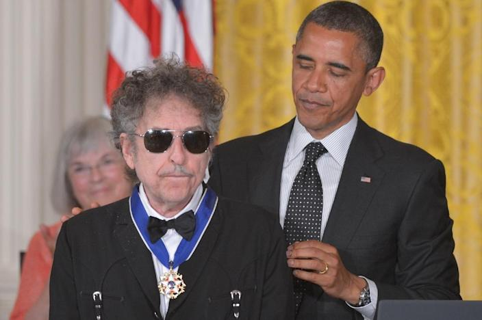 US President Barack Obama presents Bob Dylan the Presidential Medal of Freedom in 2012 at the White House, the award is the country's highest civilian honour (AFP Photo/Mandel Ngan)