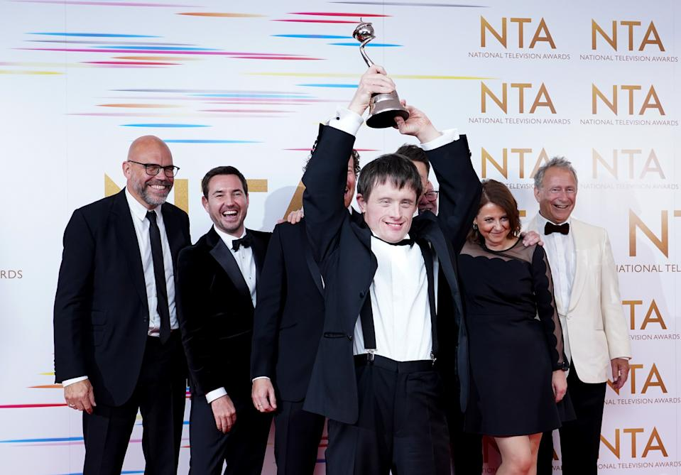Tommy Jessop celebrates in the awards room with the cast and crew of Line of Duty after winning the Returning Drama award at the National Television Awards 2021 held at the O2 Arena, London. Picture date: Thursday September 9, 2021. (Photo by Ian West/PA Images via Getty Images)