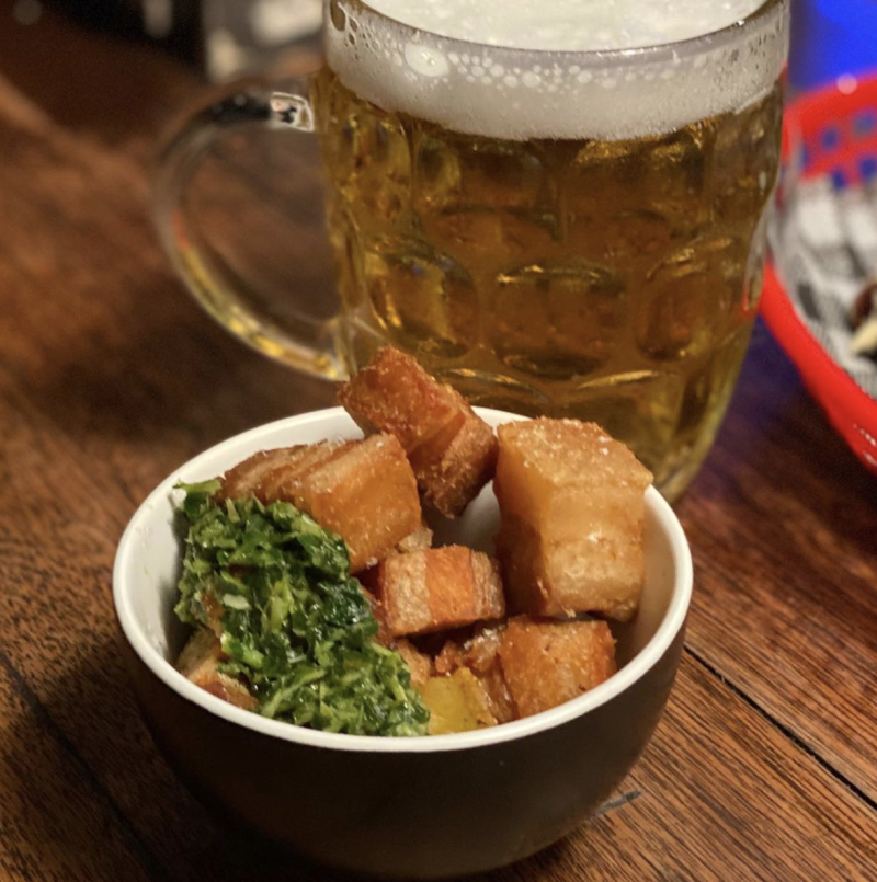 The Pork belly crackling with salsa and a stein of beer at Brisbane's Fat Angel Sports Bar and Grill