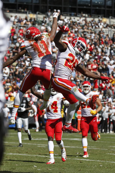 Kansas City Chiefs wide receiver Demarcus Robinson (11) is greeted by running back Damien Williams, right, after scoring a touchdown during the first half of an NFL football game against the Oakland Raiders Sunday, Sept. 15, 2019, in Oakland, Calif. (AP Photo/D. Ross Cameron)