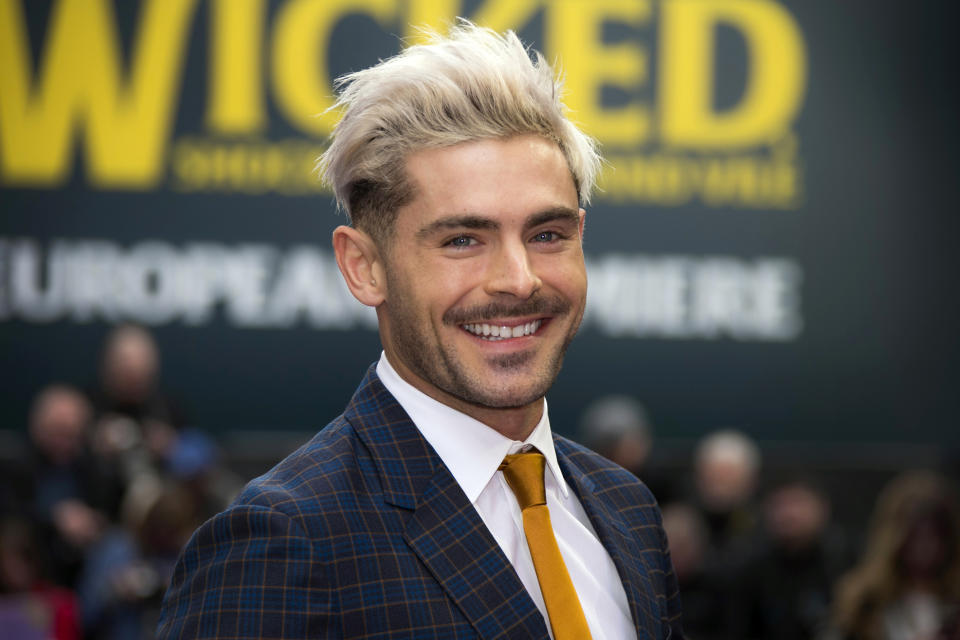 """FILE - In this Wednesday, April 24, 2019, file photo, actor Zac Efron poses for photographers upon arrival at a premiere in London. On his Twitter and Instagram accounts Sunday, Dec. 29, 2019, Efron said he has has """"bounced back"""" after an illness while filming a show in Papua New Guinea. (Photo by Joel C Ryan/Invision/AP, File)"""