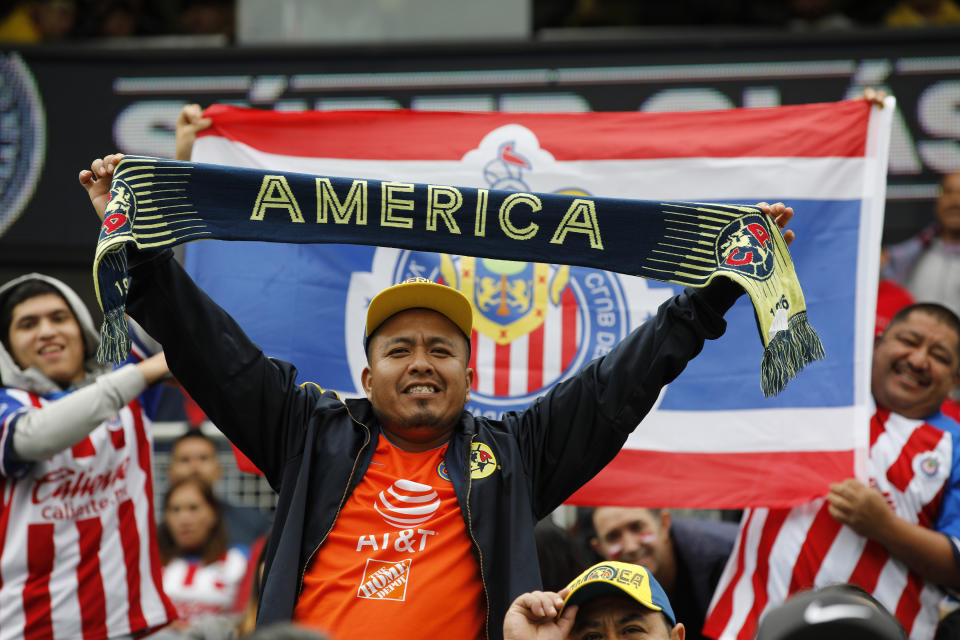 Club America and Chivas de Guadalajara fans cheer before a Super Clasico soccer match Sunday, Sept. 8, 2019, in Chicago. (AP Photo/Jim Young)