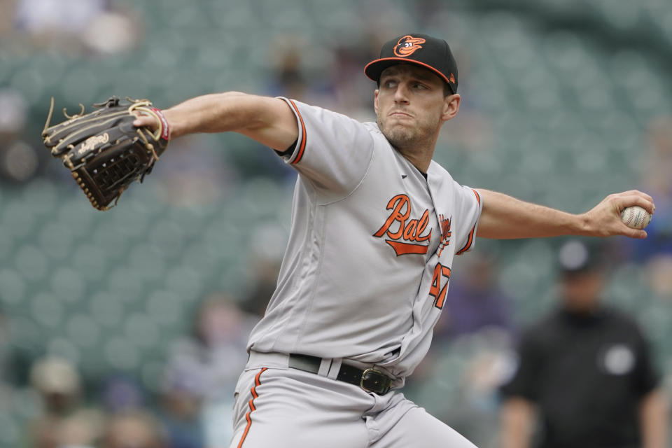 Baltimore Orioles starting pitcher John Means throws against the Seattle Mariners.