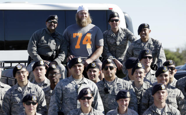 FILE - In this Jan. 22, 2015, file photo, New York Jets' Nick Mangold poses for a picture after a practice session at Luke Air Force Base for the NFL Football Pro Bowl, in Glendale, Ariz. Former New York Jets center Nick Mangold has announced his retirement from playing football after 11 seasons in which he established himself as one of the NFL's best at his position. The 34-year-old Mangold announced on Twitter on Tuesday morning, April 17, 2018, that he will sign a one-day contract with the Jets to retire as a member of the team.(AP Photo/David J. Phillip, File)