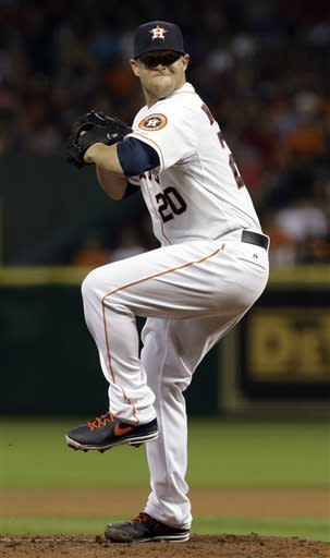 Houston Astros' Bud Norris winds up to pitch against the Texas Rangers in the fourth inning of a baseball game, Sunday, March 31, 2013, in Houston. (AP Photo/Pat Sullivan)