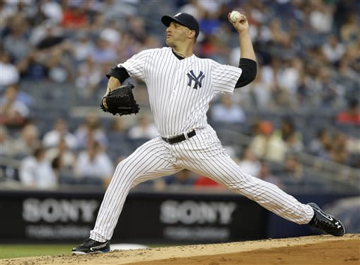 New York Yankees starting pitcher Andy Pettitte delivers in the first inning of a baseball game against the Texas Rangers on Wednesday, June 26, 2013, in New York. (AP Photo/Kathy Willens)
