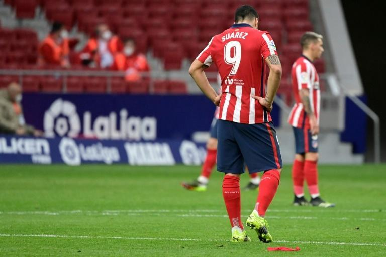 Atletico Madrid missed the chance to extend their lead at the top of La Liga on Saturday