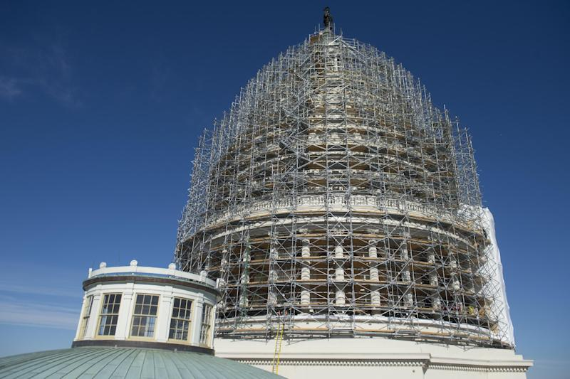 Scaffolding covers the dome of the US Capitol during a restoration project in Washington, DC, on November 18, 2014