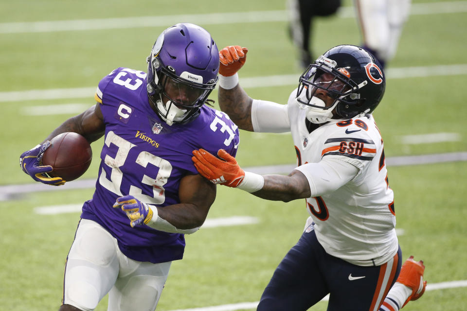 Minnesota Vikings running back Dalvin Cook (33) runs from Chicago Bears safety Eddie Jackson (39) during the first half of an NFL football game, Sunday, Dec. 20, 2020, in Minneapolis. (AP Photo/Bruce Kluckhohn)