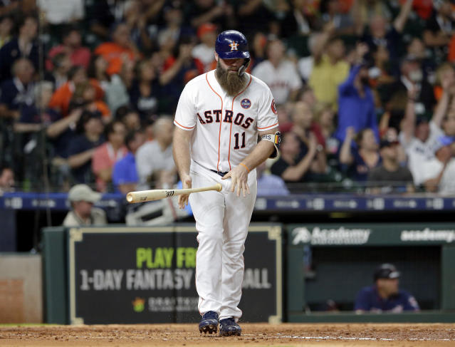 Houston Astros designated hitter Evan Gattis flips his bat after hitting a two-run home run against the Minnesota Twins during the fourth inning of a baseball game Wednesday Sept. 5, 2018, in Houston. (AP Photo/Michael Wyke)