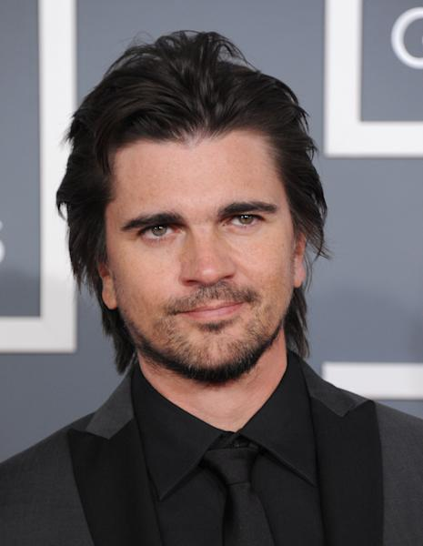 Colombian singer Juanes arrives at the 55th annual Grammy Awards on Sunday, Feb. 10, 2013, in Los Angeles. (Photo by Jordan Strauss/Invision/AP)