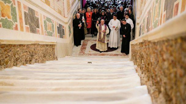 PHOTO:The Cardinal Vicar of Rome, Angelo De Donatis, blesses the restored Holy Stairs (Scala Sancta), which according to Catholic Church is the stair on which Jesus Christ stepped leading on his way to the crucifixion, in Rome, Thursday, April 11, 2019. (Andrew Medichini/AP)