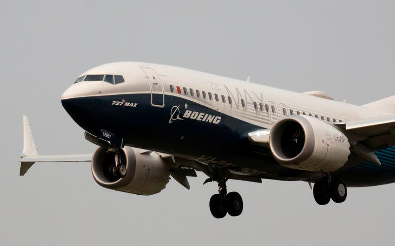 FILE PHOTO: A Boeing 737 MAX aircraft lands during an evaluation flight in Seattle, United States