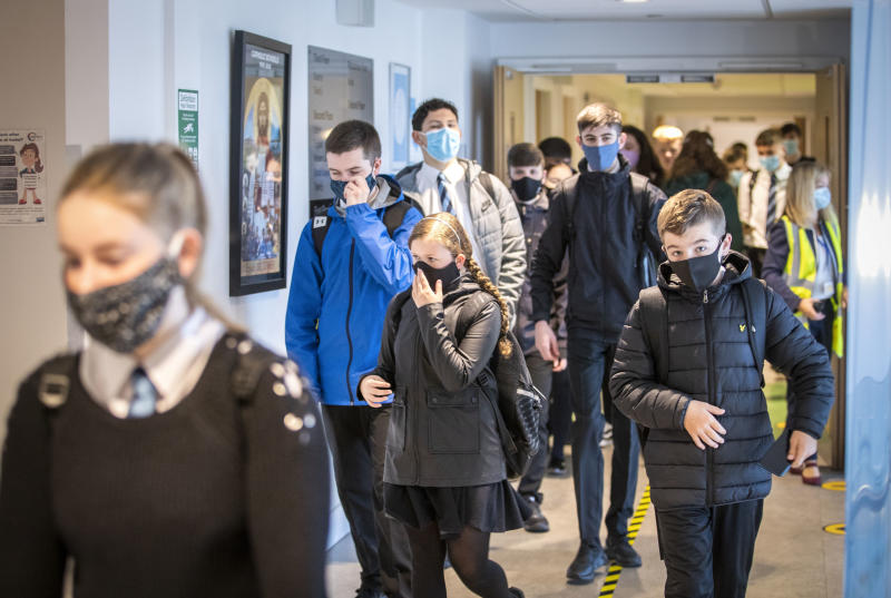 Students at St Columba's High School, Gourock, Scotland, wear protective face masks as the requirement for secondary school pupils when moving around school comes into effect from today across Scotland, Monday Aug. 31, 2020. (Jane Barlow/PA via AP)