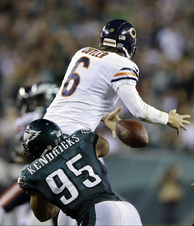 Chicago Bears' Jay Cutler (6) fumbles the ball as he is hit by Philadelphia Eagles' Mychal Kendricks (95) during the second half of an NFL football game, Sunday, Dec. 22, 2013, in Philadelphia. (AP Photo/Michael Perez)