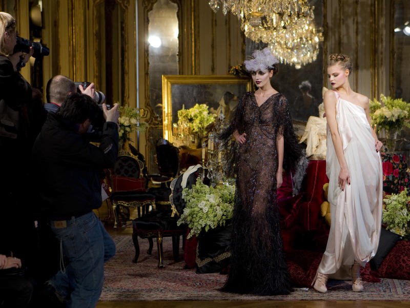 A model wears a creation from designer John Galliano as part of his Fall-Winter, ready-to-wear 2012 fashion collection, during Paris Fashion week, Sunday, March 6, 2011. (AP Photo/Joel Ryan)