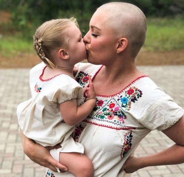 PHOTO: Sarah Sharpe holds her daughter Charlotte, 4, in a photo taken while she underwent chemotherapy treatments. (Courtesy Sarah Sharp and Cathey Stoner)